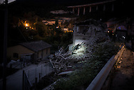 A car is seen in the rumble of Pescara del Tronto a village heavily damaged by the 6,2 earthquake that hit central Italy on the 24 August.