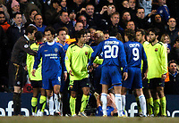 Photo: Richard Lane.<br />Chelsea v Barcelona. UEFA Champions League. 22/02/2006.<br />Chelsea and Barcelona players clash over the incident which saw Chelsea's Asier Del Horno (ground) sent off.