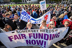 © Licensed to London News Pictures. 28/09/2018. LONDON, UK. Head teachers with a banner join hundreds of other head teachers at a rally in Parliament Square to demand extra funding for schools ahead of a petition being delivered to Number 11 Downing Street.  With a reported reduction in per student funding in real terms since 2010, members of the National Union of Head Teachers and the Association of School and College Leaders attending the rally also warn of increasing class sizes, staff cuts, and reduced subject choice.  Photo credit: Stephen Chung/LNP