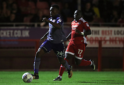 Charlton Athletic's Dennon Lewis and Crawley Town's Joe Aribo battle for the ball