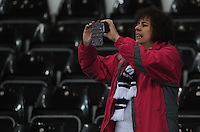 A Swansea City fan takes a photo during the pre-match warm-up <br /> <br /> Photographer Kevin Barnes/CameraSport<br /> <br /> Football - Barclays Premiership - Swansea City v Liverpool - Monday 16th March - The Liberty Stadium - Swansea<br /> <br /> © CameraSport - 43 Linden Ave. Countesthorpe. Leicester. England. LE8 5PG - Tel: +44 (0) 116 277 4147 - admin@camerasport.com - www.camerasport.com