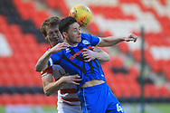 Ian Henderson is tackled during the EFL Sky Bet League 1 match between Doncaster Rovers and Rochdale at the Keepmoat Stadium, Doncaster, England on 1 January 2019.