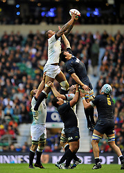 Courtney Lawes (England) rises high to win lineout ball - Photo mandatory by-line: Patrick Khachfe/JMP - Tel: Mobile: 07966 386802 09/11/2013 - SPORT - RUGBY UNION -  Twickenham Stadium, London - England v Argentina - QBE Autumn Internationals.