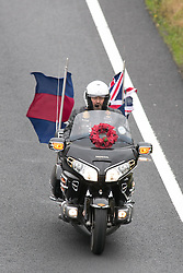 "© Licensed to London News Pictures. 3/10/2015, Tamworth, Staffordshire, UK. The eighth Ride to the Wall ""RTTW"" took place today with thousands of motorcyclists arriving at the National Memorial Arboretum. Starting at eleven designated points around the country, the riders came from all over the UK as well as continental Europe.They rode to visit the walls of the Armed Forces Memorial where the names of 16,000 service men and women are engraved to remember those killed on duty or by terrorist action since the end of the Second World War. A display by the white helmets, tiger moth flypast and memorial service formed part of the day. Pictured, riders make their way along the A5 through Tamworth towards the NMA. Photo credit / Dave Warren/LNP"