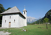 The nineteenth century Roman Catholic church in Teth. The church has the stone walls and shingled roof typical of the region. Teth, Tethi, Albania. 03Sep15