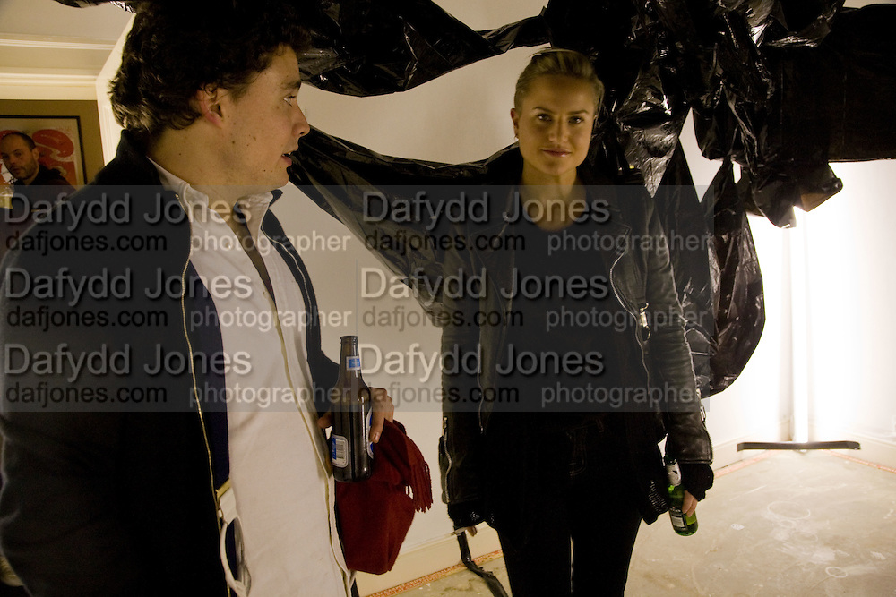ADAM WAYMOUTH; OLYMPIA SCARRY. Come and Check My Gaff. Mixed exhibition in an empty house in Chelsea. I Petyt Place. London. 16 December 2008. Exhibition on until 21 December.  *** Local Caption *** -DO NOT ARCHIVE-© Copyright Photograph by Dafydd Jones. 248 Clapham Rd. London SW9 0PZ. Tel 0207 820 0771. www.dafjones.com.<br /> ADAM WAYMOUTH; OLYMPIA SCARRY. Come and Check My Gaff. Mixed exhibition in an empty house in Chelsea. I Petyt Place. London. 16 December 2008. Exhibition on until 21 December.