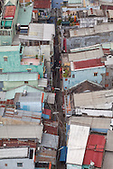 """Close aerial view of a neighborhood in Cholon with typical colored rectangular houses also called """"tube houses,"""" some just four meters wide, Ho Chi Minh City, Vietnam, Southeast Asia"""