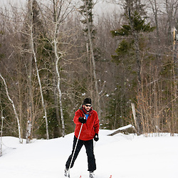 A man cross country skiing on the Catamount Trail in Stowe, Vermont.