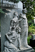 Grieving young family statue Novodevichy Cemetery, Moscow, Russia
