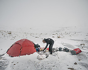 """Camping below the Irshad Pass (4950m) into Pakistan's Chapursan valley. I was also worried about avalanches, trouble sleeping, high altitude. Guiding and photographing Paul Salopek while trekking with 2 donkeys across the """"Roof of the World"""", through the Afghan Pamir and Hindukush mountains, into Pakistan and the Karakoram mountains of the Greater Western Himalaya."""