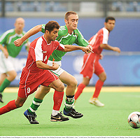 8 September 2008; Ireland's Derek Malone, from Whitegate, Co. Clare, in action against Morteza Heidari, Iran. Beijing Paralympic Games 2008, Ireland v Iran, 7-A-Side Soccer, First Round, Group B, Olympic Green Hockey Field A, Beijing, China. Picture credit: Brian Lawless / SPORTSFILE