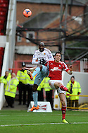 Nottingham Forest's Greg Halford ® is challenged by West Ham's Alou Diarra. FA Cup with Budweiser, 3rd round, Nottingham Forest v West Ham Utd match at the City Ground in Nottingham, England on Sunday 5th Jan 2014.<br /> pic by Andrew Orchard, Andrew Orchard sports photography.