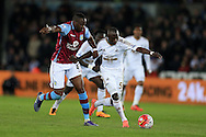 Modou Barrow of Swansea city breaks away from Aly Cissokho of Aston Villa (l). Barclays Premier league match, Swansea city v Aston Villa at the Liberty Stadium in Swansea, South Wales on Saturday 19th March 2016.<br /> pic by  Andrew Orchard, Andrew Orchard sports photography.
