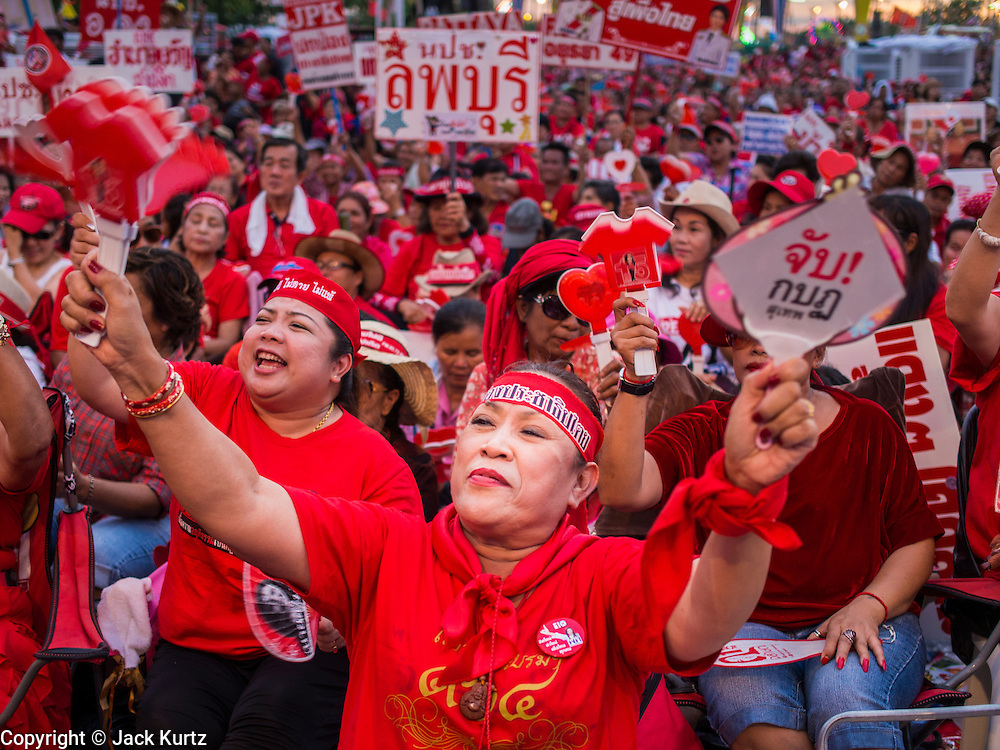 17 MAY 2014 - BANGKOK, THAILAND: Red Shirt supporters cheer at a rally on Aksa Road in Bangkok. Thousands of Thai Red Shirts, members of the United Front for Democracy Against Dictatorship (UDD), members of the ruling Pheu Thai party and supporters of the government of ousted Prime Minister Yingluck Shinawatra are rallying on Aksa Road in the Bangkok suburbs. The government was ousted by a court ruling earlier in the week that deposed Yingluck because the judges said she acted unconstitutionally in a personnel matter early in her administration. Thailand now has no functioning government. Red Shirt leaders said at the rally Saturday that any attempt to impose an unelected government on Thailand could spark a civil war. This is the third consecutive popularly elected UDD supported government ousted by the courts in less than 10 years.    PHOTO BY JACK KURTZ