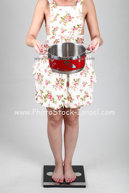 Woman with cooking pot stand on scale Model released