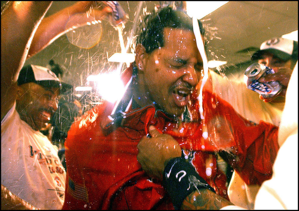 """""""Winning Shower"""" - Boston Red Sox vs Baltimore Orioles. Red Sox clinch the American League Wild Card Playoff spot. .Manny Ramirez gets doused with champagne in celebration inside the locker room. bcadf"""