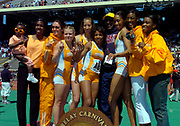 Bill Cosby poses with the University of Tennessee women's team (from left), alumnus Joetta Clark-Diggs with child, Caitlin Ward, Brook Novak, Leslie Treherne, Nicole Cook, Cosby, Kameisha Bennett, Dee Dee Trotter and Toyin Olupona at the110th Penn Relays at the University of Pennsylvania's Franklin Field on Saturday, April 24, 2004 in Philadelphia.