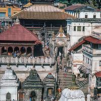 Pagoda roofs rise above Pashupatinath Temple in Kathmandu, Nepal, 1986.