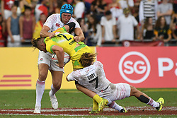 2018?4?29?.???????——HSBC????????????????????——???????..4?29????????Tom Connor???2???????????Dan Bibby???7???????Richard de Carpentier????????????????????HSBC???????????????????????.???? ??????..Australia's player Tom Connor (C, no 2 yellow jersey) tries to get past England's players Dan Bibby (R, no 7 jersey) and Richard de Carpentier (Back, white jersey) during the semi-finals match of the HSBC World Rugby Sevens Series Singapore held in Singapore's National Stadium on Apr 29, 2018..By Xinhua, Then Chih Wey..????????????2018?4?29? (Credit Image: © Then Chih Wey/Xinhua via ZUMA Wire)