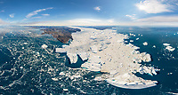 Aerial view of big glacier breaking up in Greenland during the day.