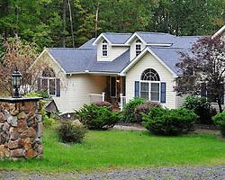 The family home of Eric Frein at 308 Seneca Lane. Police converge on Barrett Township in the Pocono Mountains in search of ambush suspect Eric Matthew Frein who is accused of shooting two Pennsylvania State Troopers Sept. 25th, 2014 in Canadensis, Pennsylvania (Chris Post | lehighvalleylive.com)