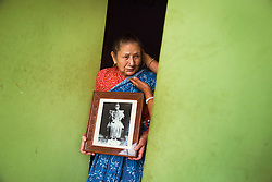 Nani Shova Shakya holds a photo from her time as Royal Kumari in the 1940s.