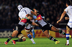 Chris Robshaw and Jordan Turner-Hall of Harlequins tackle William Whetton of Castres Olympique - Photo mandatory by-line: Patrick Khachfe/JMP - Mobile: 07966 386802 17/10/2014 - SPORT - RUGBY UNION - London - Twickenham Stoop - Harlequins v Castres Olympique - European Rugby Champions Cup