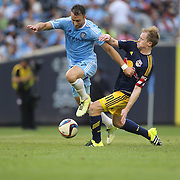 RJ Allen, (left), NYCFC, is challenged by Dax McCarty, New York Red Bulls, during the New York City FC Vs New York Red Bulls, MSL regular season football match at Yankee Stadium, The Bronx, New York,  USA. 28th June 2015. Photo Tim Clayton