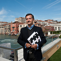 Curator  Luca Massimo Barbero poses on the terrace of the Guggenheim Museum on the Grand Canal in Venice ahead of the Press Preview of the Capogrossi Exhibition From September 30th 2012 to February 10th 2013.This retrospective explores Giuseppe Capogrossi's (1900-72) unique contribution to 20th-century art, tracing the evolution of his signature glyph in grandiose orchestrations of abstract mark and color.