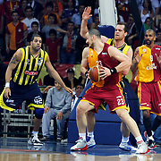 Galatasaray's Ermal KURTOGLU (F), Preston SHUMPERT (R) and Fenerbahce's Sean Gregory MAY (L), Oguz SAVAS (2ndR) during their Turkish Basketball league Play Off Final fourth leg match Galatasaray between Fenerbahce Ulker at the Abdi Ipekci Arena in Istanbul Turkey on Saturday 11 June 2011. Photo by TURKPIX