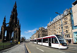 Edinburgh, Scotland, UK. 8 April 2020. Images from Edinburgh during the continuing Coronavirus lockdown. Pictured; View of an Edinburgh Tram on an empty Princes Street. Iain Masterton/Alamy Live News.
