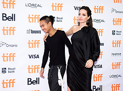 """Director and Actress Angelina Jolie and her son Maddox Jolie-Pitt pose for photographs on the red carpet for the movie """"First They Killed My Father"""" during the 2017 Toronto International Film Festival in Toronto, ON, Canada, on Monday, September 11, 2017. Photo by Nathan Denette/CP/ABACAPRESS.COM"""
