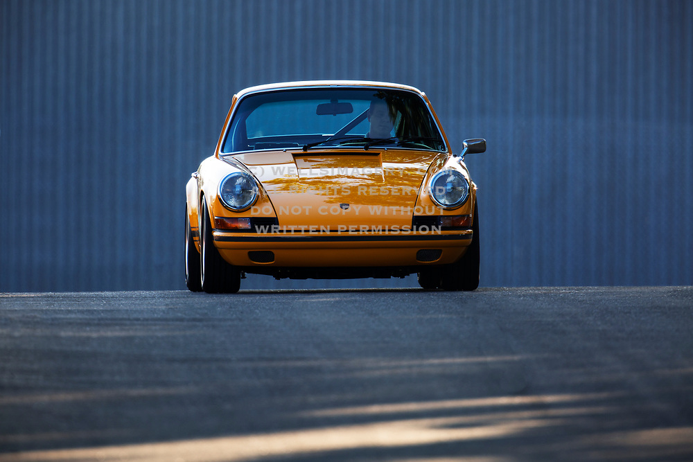 Image of a Signal Yellow 1973 Porsche 911 R Gruppe hot rod in California, America west coast by Randy Wells