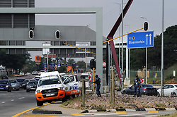 140418 Johannesburg. Winnie Madikizela-Mandela funeral.  JMPD Metro cops and SAPS police ait at the William Nicol offamp in order to close the intersection off when the funeral motorcade comes though later in the day. Picture: Karen Sandison/African News Agency (ANA)