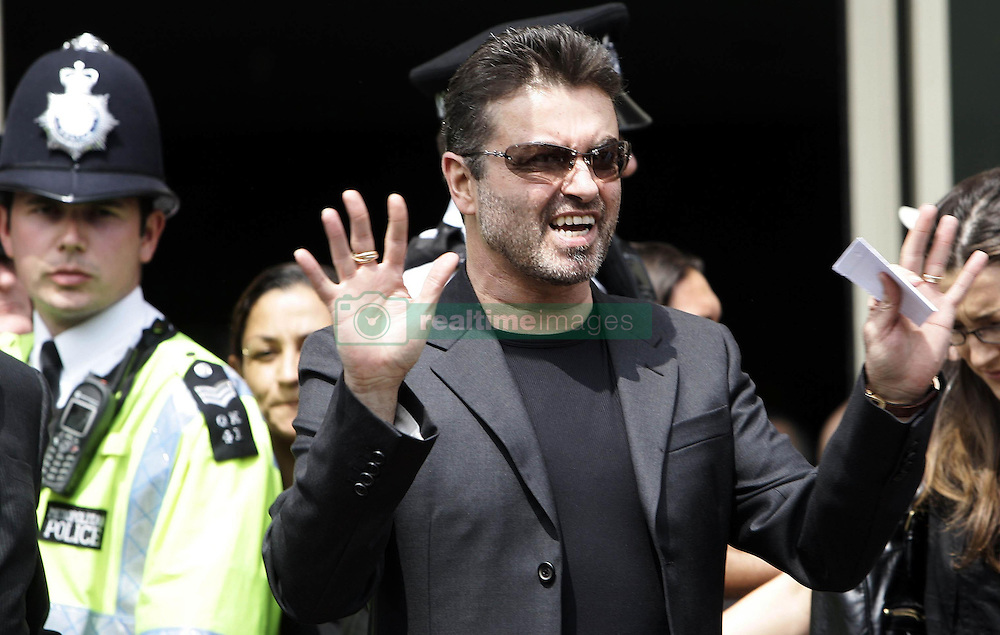 File photo dated 08/06/2007 of George Michael makes a statement to the press outside Brent Magistrate's Court after he was sentenced to 100 hours community service for driving while unfit, as the pop superstar has died peacefully at home, his publicist said.