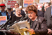23 JANUARY 2012 - PHOENIX, AZ:   State Sen Gail Griffin (CQ) reads newspaper accounts of crimes allegedly committed by immigrants during a Republican press conference at the State Capitol Monday, Jan 23. Both sides of the immigration debate congregated on the capitol grounds to protest against and in favor of SB 1070 and other anti immigration bills. At the same time people were protesting, legislators from both sides of the issue held press conferences.      PHOTO BY JACK KURTZ