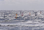 Windsurfers on the water near the nuclear power plant. Haroka, Japan.