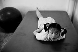 Jiang Jiarui, 9, of Hanwang, trains at the Sichuan Limbs Maim Restoration Centre in Chengdu, Sichuan in China.