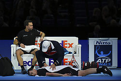 November 15, 2017 - London, England, United Kingdom - Jamie Murray of Great Britain partner of Bruno Soares of Brazil recieves treatment following an injury during the doubles match against Ivan Dodig of Croatia and Marcel Granollers of Spain on day four of the 2017 Nitto ATP World Tour Finals at O2 Arena, London on November 15, 2017. (Credit Image: © Alberto Pezzali/NurPhoto via ZUMA Press)