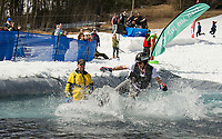 Andrew Mozier along with the judges panel watch Joel Huleatt attempt to cross the pond during Gunstock Mountain's annual BYODC event on Saturday.  (Karen Bobotas/for the Laconia Daily Sun)