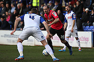 Oldham Athletic's  Gary Harkins (c) takes on Tranmere Rovers' Ash Taylor. Skybet football league 1match, Tranmere Rovers v Oldham Athletic at Prenton Park in Birkenhead, England on Saturday 1st March 2014.<br /> pic by Chris Stading, Andrew Orchard sports photography.