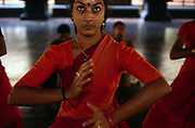 """Girls practice Mohiniyattam (also spelled Mohiniattam), Kerala's sole classical dance for women.<br /> The dance literally means """"dance of the enchantress"""" and had all but disappeared before it was reintroduced at the Kerala Kalamadalam.<br /> The Kalamandalam was founded in 1930 to preserve the cultural traditions of Kathakali, the stylised dance drama of Kerala. Kathakali is the classical dance-drama of Kerala, South India, which dates from the 17th century and is rooted in Hindu mythology. Kathakali is a unique combination of literature, music, painting, acting and dance performed by actors wearing extensive make up and elaborate costume who perform plays which retell in dance form stories from the Hindu epics."""