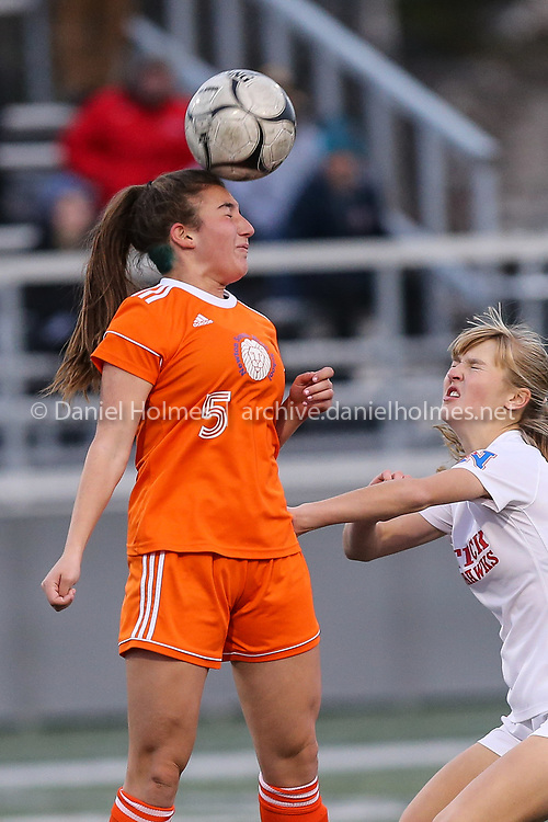 (11/12/18, HINGHAM, MA) Newton South's Bella Ertel  heads the ball during the Lions loss to Natick in the Division 1 South girls soccer sectional finals at Hingham High School on Monday. [Daily News and Wicked Local Photo/Dan Holmes]