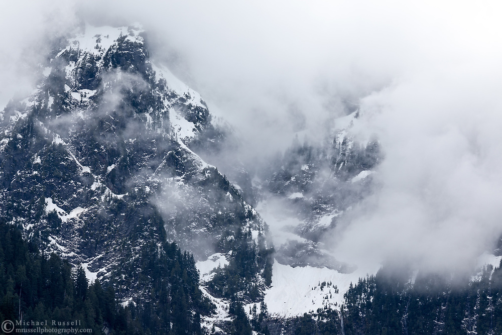 Mount Blanshard (The Golden Ears) briefly shows through the clouds in Golden Ears Provincial Park.  Photographed in Maple Ridge, British Columbia, Canada.
