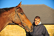 2010 Gold Cup winner, Imperial Commander, gallops up the hill at Nigel Twiston Davies yard.