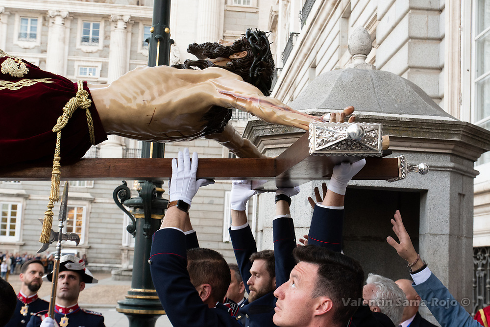 Madrid, Spain. 16th April, 2019. Members of confraternity of the 'Cristo de los Alabarderos' holding the figure at the gate of the Royal Palace. © Valentin Sama-Rojo