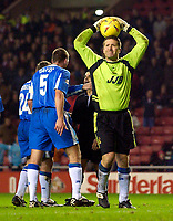 Photo. Jed Wee.<br /> Sunderland v Wigan Athletic, Nationwide League Division One, Stadium of Light, Sunderland. 02/12/03.<br /> Wigan goalkeeper John Filan (R) shows exactly what he thinks of the penalty decision as in the background his team mates protest to referee A Kaye.