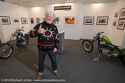 Biker Billy (Alfredo Cella) manning the Michael Lichter photography display at the Motor Bike Expo. Verona, Italy. January 24, 2016.  Photography ©2016 Michael Lichter.
