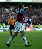 Photo. Matthew Lewis.<br /> Wolverhampton Wanderers v West Ham United. FA Cup 4th Round. 25/01/2004.<br /> <br /> West Hams' David Connolly celebrates scoring his teams third goal against Wolves.