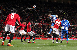 Brighton & Hove Albion's Lewis Dunk heads at goal during the Emirates FA Cup, quarter final match at Old Trafford, Manchester.